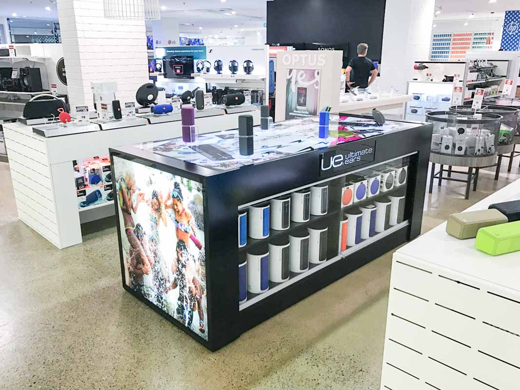 Genesis Retail Displays interactive pos display manufacturer in Australia creating a play table for Ultimate Ears UE BOOM range of bluetooth speakers without a head board 1