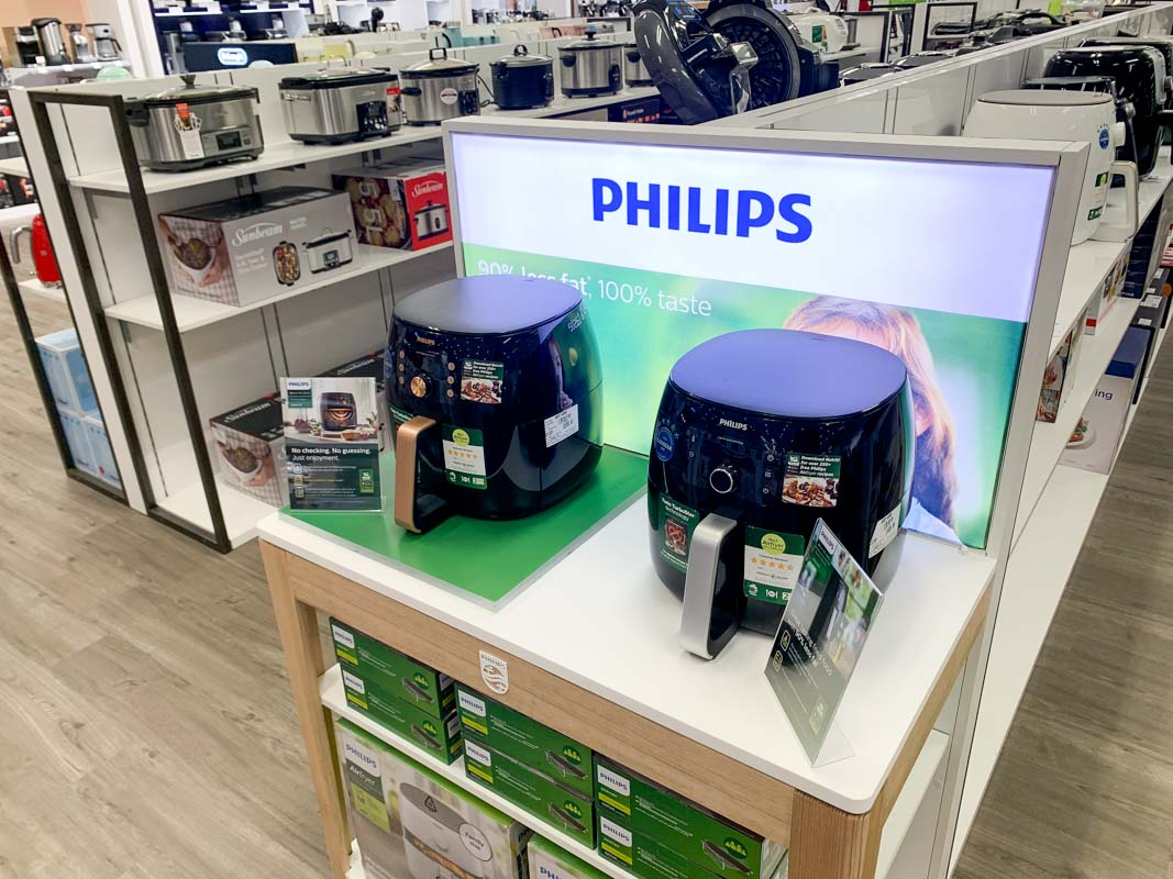 Permanent end cap displays that are interactive to demonstrate products in retail stores designed by Genesis Retail Displays 5