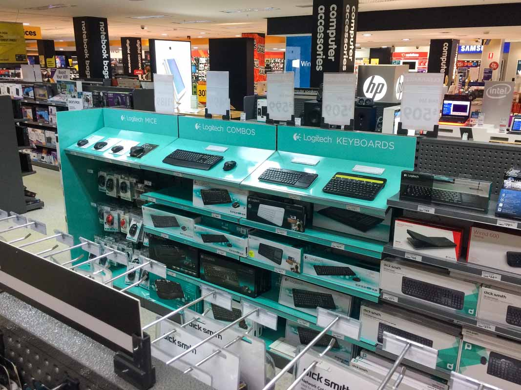 Custom designed permanent retail point of sale displays for products in retail by Genesis Retail Displays pop manufacturer in Sydney aisle bay shelving