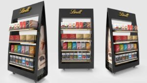 Woolworths Off Location Retail POS Displays Genesis Retail Displays custom design for a metal free standing display unit for Lindt confectionary for supermarket placement concept idea rounded edges triangle shape