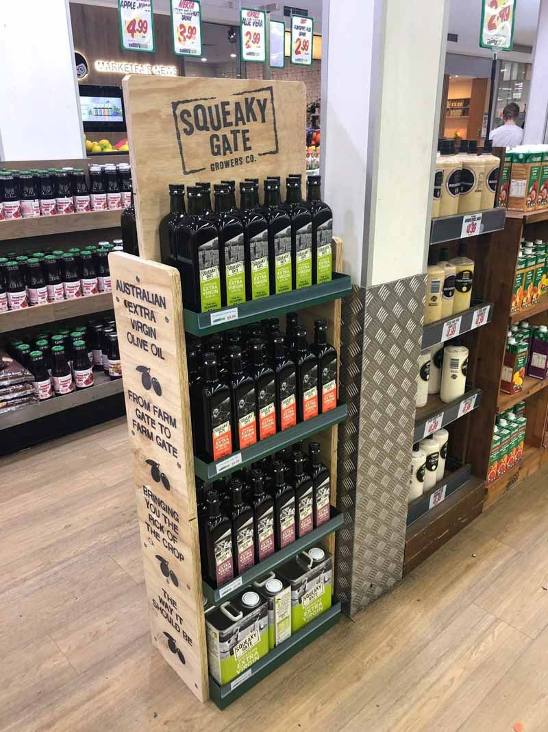 Squeaky Gate custom designed wooden pos display for olive oil in a supermarket designed by Genesis Retail Displays in Sydney